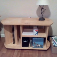 Coffee table with CD storage and shelves